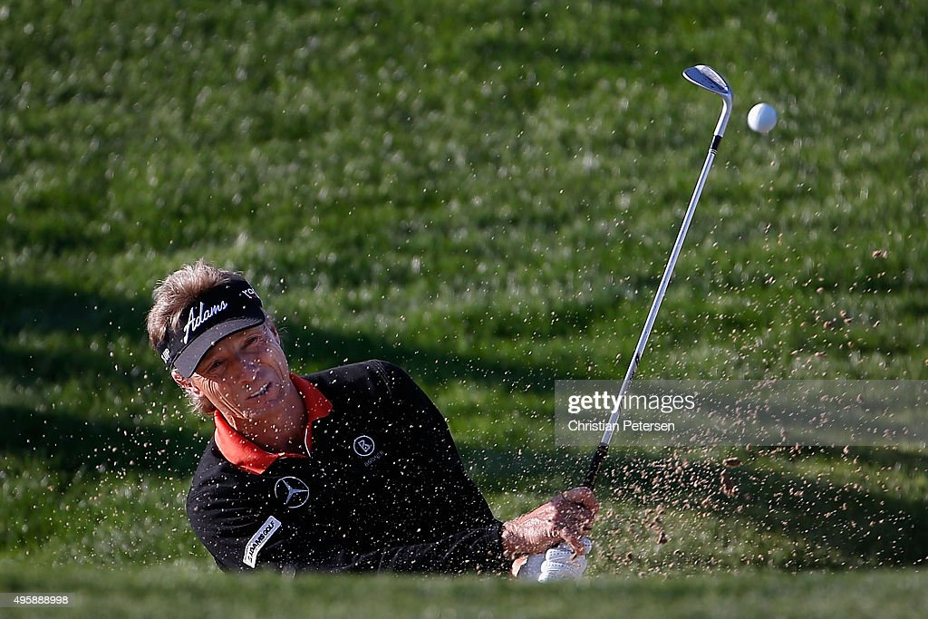 Bernhard Langer of Germany chips from the bunker onto the 17th green during the first round of the Charles Schwab Cup Championship on the Cochise...