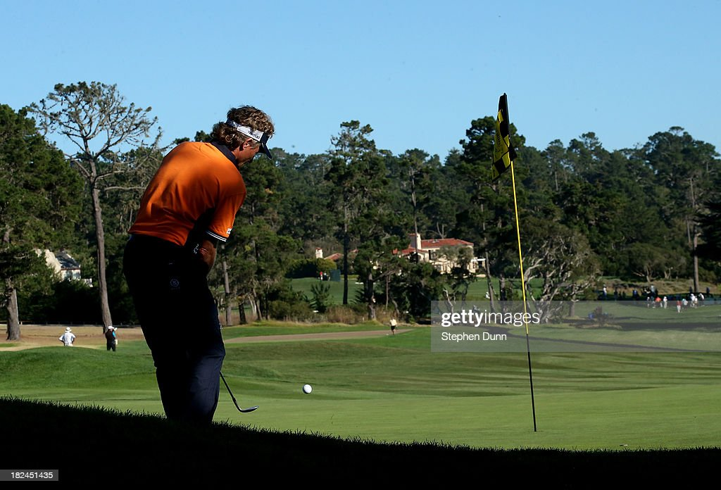 Bernhard Langer of Germany chips onto the green on the 13th hole durng the final round of the Nature Valley First Tee Open at Pebble Beach at Pebble Beach Golf Links on September 29, 2013 in Pebble Beach, California.