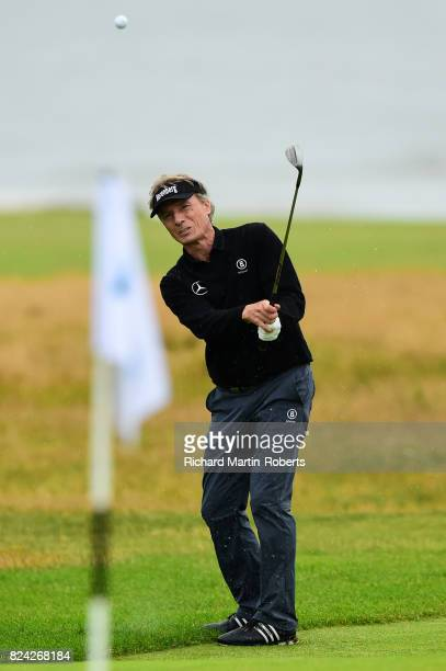Bernhard Langer of Germany chips to the 18th green during the third round of the Senior Open Championship presented by Rolex at Royal Porthcawl Golf...