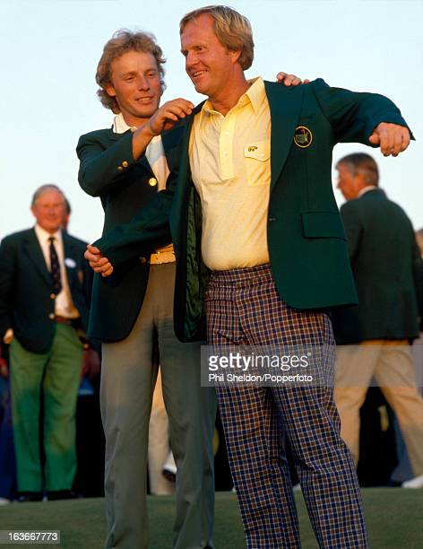 Bernhard Langer of Germany helps Jack Nicklaus of the United States into his Green Jacket for winning the US Masters Golf Tournament held at the...