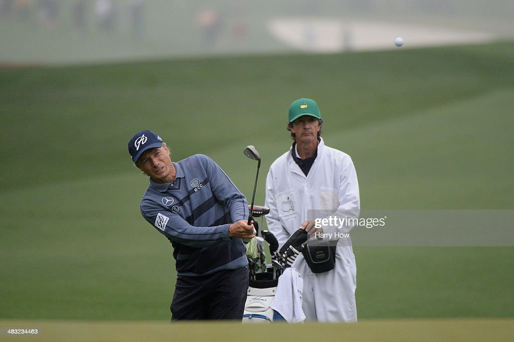 <a gi-track='captionPersonalityLinkClicked' href=/galleries/search?phrase=Bernhard+Langer&family=editorial&specificpeople=167071 ng-click='$event.stopPropagation()'>Bernhard Langer</a> of Germany hits a shot as caddie Terry Holt looks on during a practice round prior to the start of the 2014 Masters Tournament at Augusta National Golf Club on April 7, 2014 in Augusta, Georgia.