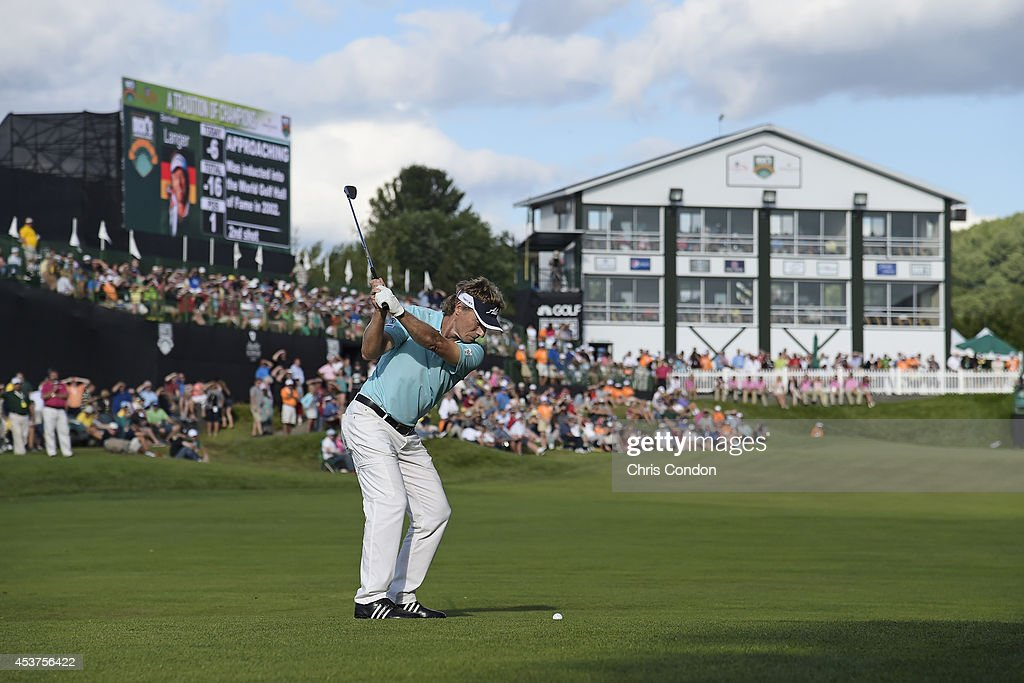 <a gi-track='captionPersonalityLinkClicked' href=/galleries/search?phrase=Bernhard+Langer&family=editorial&specificpeople=167071 ng-click='$event.stopPropagation()'>Bernhard Langer</a> of Germany hits his approach on the 18th hole during the final round of the Champions Tour Dick's Sporting Goods Open at En-Joie Golf Course on August 17, 2014 in Endicott, New York.