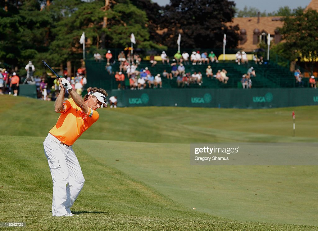 <a gi-track='captionPersonalityLinkClicked' href=/galleries/search?phrase=Bernhard+Langer&family=editorial&specificpeople=167071 ng-click='$event.stopPropagation()'>Bernhard Langer</a> of Germany hits his second shot on the 18th hole during the third round of the 2012 Senior United States Open at Indianwood Golf and Country Club on July 14, 2012 in Lake Orion, Michigan.