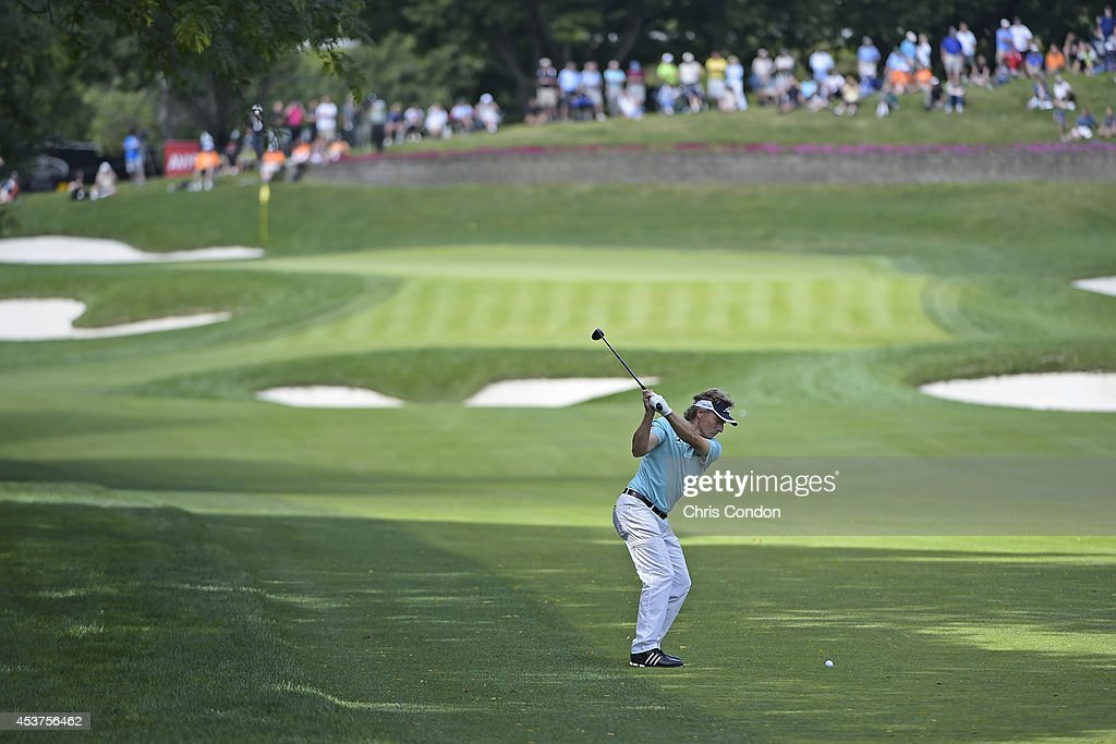 <a gi-track='captionPersonalityLinkClicked' href=/galleries/search?phrase=Bernhard+Langer&family=editorial&specificpeople=167071 ng-click='$event.stopPropagation()'>Bernhard Langer</a> of Germany hits his second shot on the 5th hole during the final round of the Champions Tour Dick's Sporting Goods Open at En-Joie Golf Course on August 17, 2014 in Endicott, New York.