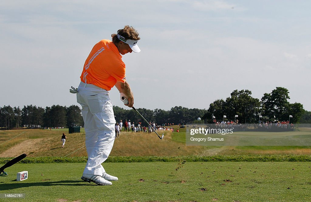 <a gi-track='captionPersonalityLinkClicked' href=/galleries/search?phrase=Bernhard+Langer&family=editorial&specificpeople=167071 ng-click='$event.stopPropagation()'>Bernhard Langer</a> of Germany hits his tee shot on the 17th hole during the third round of the 2012 Senior United States Open at Indianwood Golf and Country Club on July 14, 2012 in Lake Orion, Michigan.