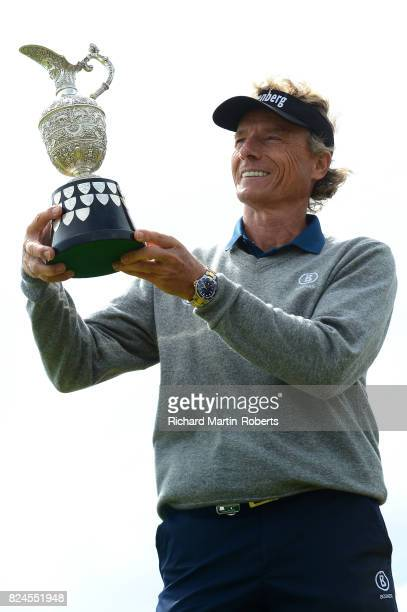 Bernhard Langer of Germany holds aloft the Senior Claret Jug following his victory during the final round of the Senior Open Championship presented...