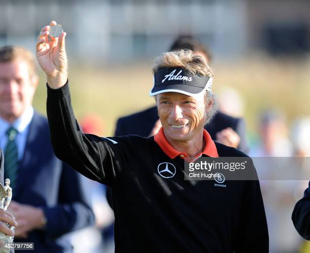 Bernhard Langer of Germany holds his winners medal up after his victory during the fourth round of the Senior Open Championship at Royal Porthcawl...
