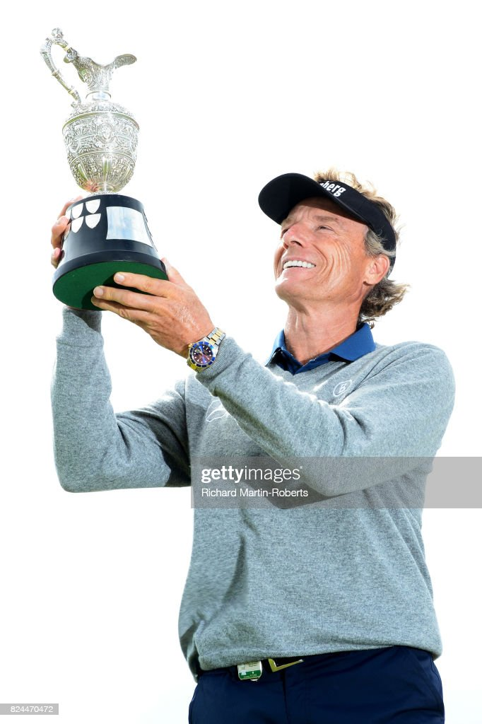 Bernhard Langer of Germany holds the Senior Claret Jug aloft following his victory during the final round of the Senior Open Championship presented by Rolex at Royal Porthcawl Golf Club on July 30, 2017 in Bridgend, Wales.
