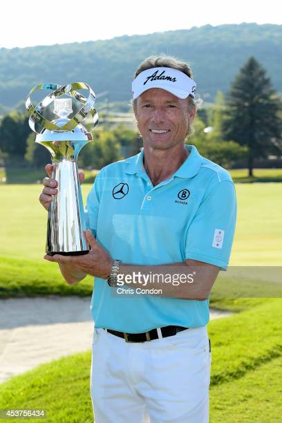 Bernhard Langer of Germany holds the tournament trophy after winning the Champions Tour Dick's Sporting Goods Open at EnJoie Golf Course on August 17...