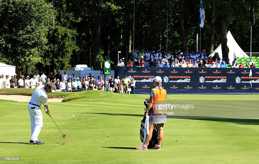 <a gi-track='captionPersonalityLinkClicked' href=/galleries/search?phrase=Bernhard+Langer&family=editorial&specificpeople=167071 ng-click='$event.stopPropagation()'>Bernhard Langer</a> of Germany in action during the first round of the Berenberg Bank Masters played at Golf- Und Land-Club Koln on August 2, 2013 in Cologne, Germany.