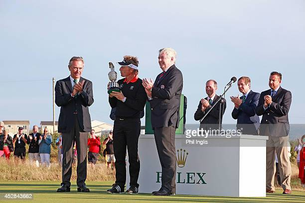 Bernhard Langer of Germany is presented with the trophy after the final round of the Senior Open Championship played at Royal Porthcawl Golf Club on...