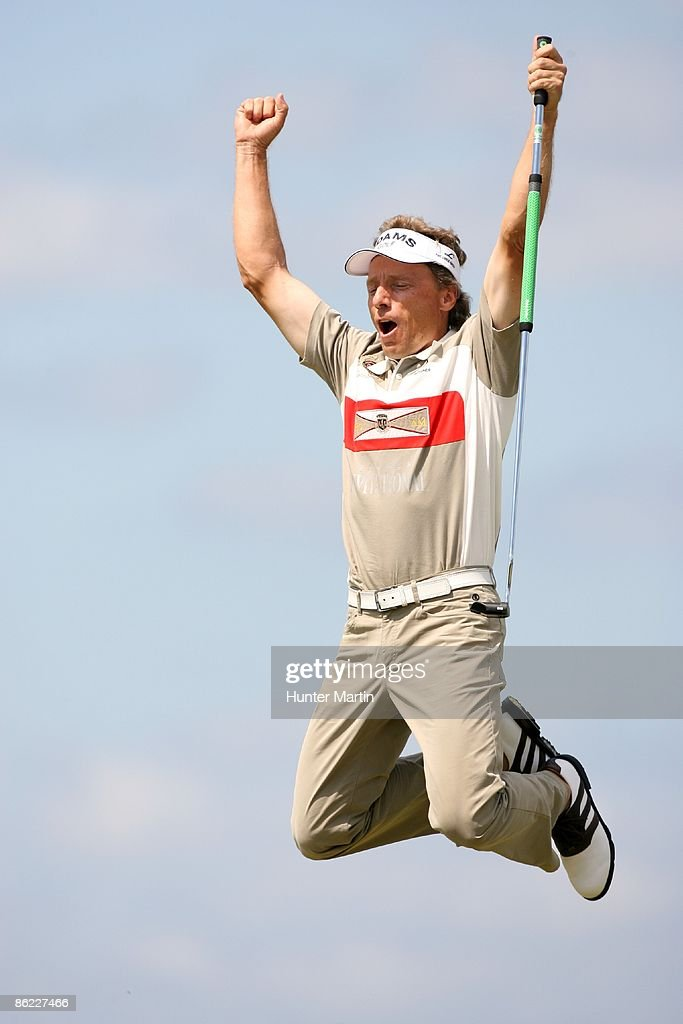Bernhard Langer of Germany jumps in the air after making a 45 foot birdie on the first playoff hole during the final round of the Liberty Mutual...