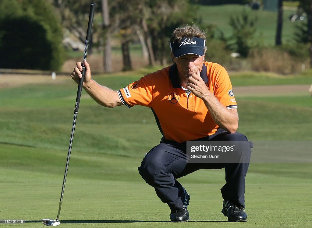 <a gi-track='captionPersonalityLinkClicked' href=/galleries/search?phrase=Bernhard+Langer&family=editorial&specificpeople=167071 ng-click='$event.stopPropagation()'>Bernhard Langer</a> of Germany lines up a putt on the 13th hole durng the final round of the Nature Valley First Tee Open at Pebble Beach at Pebble Beach Golf Links on September 29, 2013 in Pebble Beach, California.