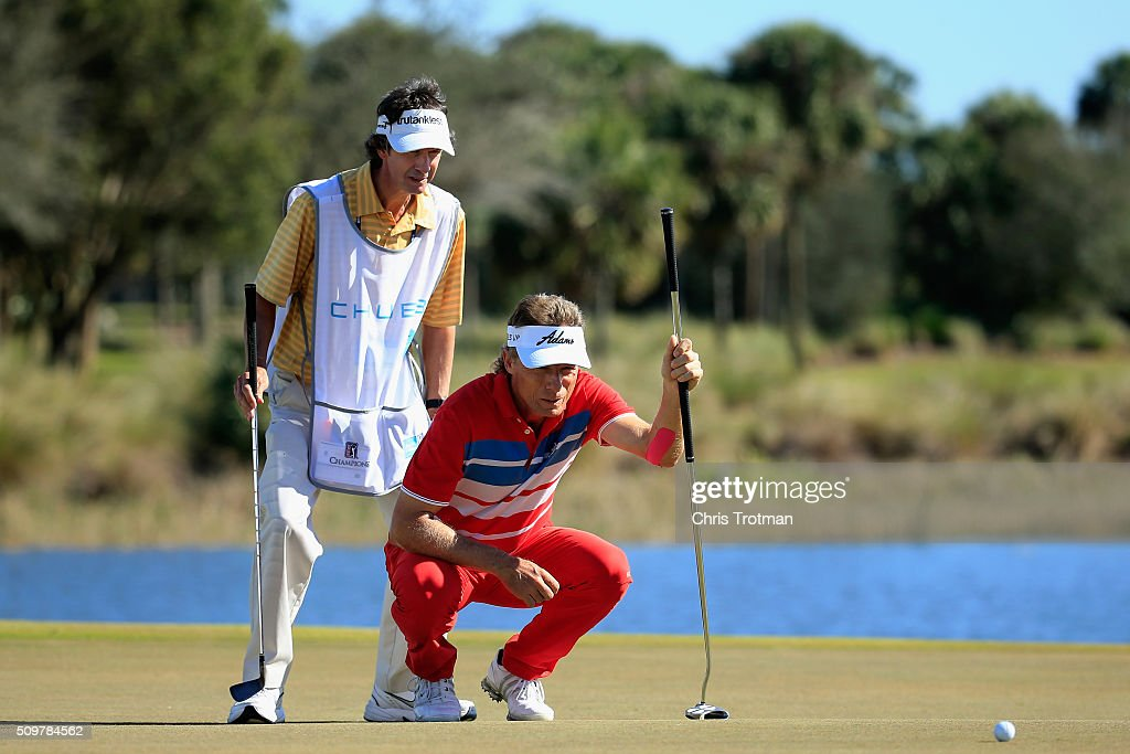 <a gi-track='captionPersonalityLinkClicked' href=/galleries/search?phrase=Bernhard+Langer&family=editorial&specificpeople=167071 ng-click='$event.stopPropagation()'>Bernhard Langer</a> of Germany lines up a putt with his caddie on the 18th green during the first round of the 2016 Chubb Classic at the TwinEagles Club on February 12, 2016 in Naples, Florida.