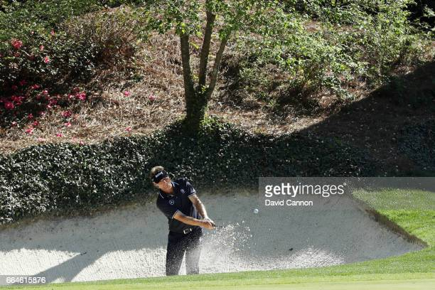 Bernhard Langer of Germany plays a shot from a bunker on the 12th hole during a practice round prior to the start of the 2017 Masters Tournament at...