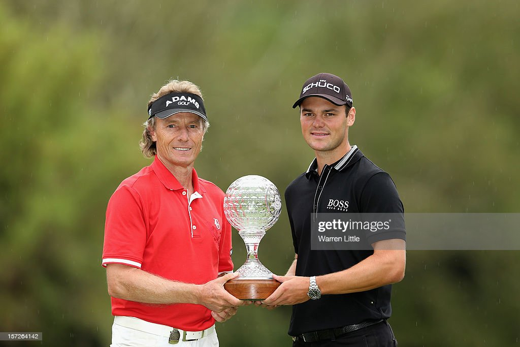 Bernhard Langer of Germany poses Martin Kaymer after winning the Nedbank Champions Challenge at the Gary Player Country Club on December 1, 2012 in Sun City, South Africa.