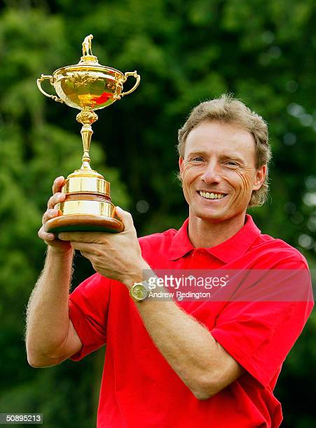Bernhard Langer of Germany poses with the Ryder Cup trophy during a Ryder Cup photocall at the Volvo PGA Championship on May 25 2004 at the Wentworth...