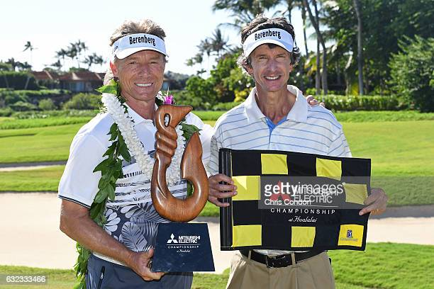 KA'UPULEHUKONA HI JANUARY 21 Bernhard Langer of Germany poses with the tournament trophy and caddie Terry Holt after winning the weathershortened PGA...