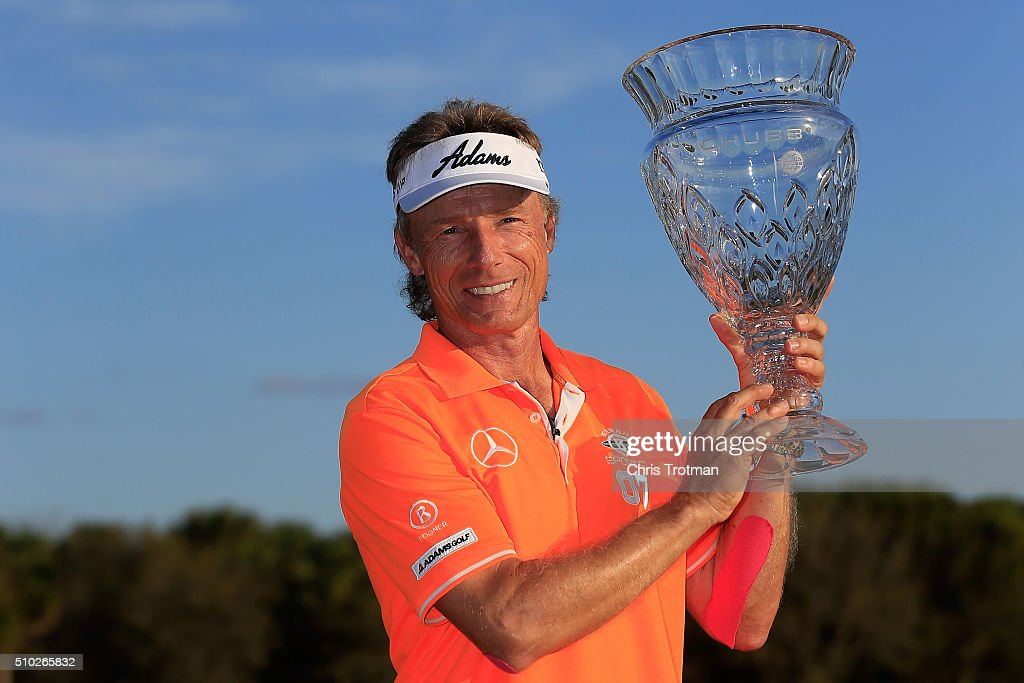 Bernhard Langer of Germany poses with the trophy on the 18th green after the final round of the 2016 Chubb Classic at the TwinEagles Club on February 14, 2016 in Naples, Florida.