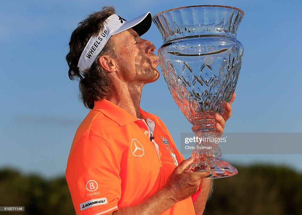 Bernhard Langer of Germany poses with the trophy on the 18th green after the final round of the 2016 Chubb Classic at the TwinEagles Club on February...