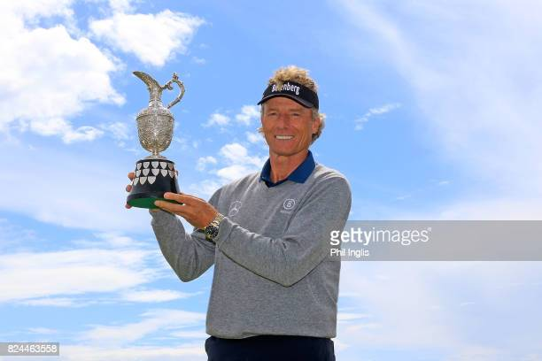 Bernhard Langer of Germany poses with the winners trophy after the final round of the Senior Open Championship at Royal Porthcawl Golf Club on July...