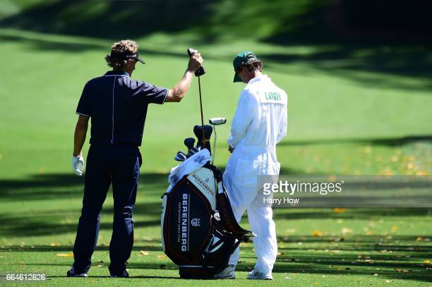 Bernhard Langer of Germany pulls a club before playing a shot on the tenth tee during a practice round prior to the start of the 2017 Masters...