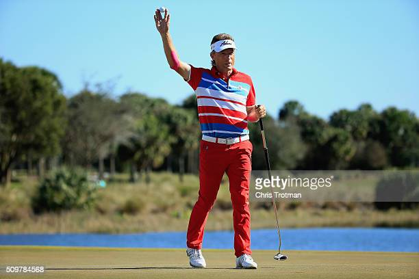 Bernhard Langer of Germany reacts after a birdie on the 18th hole during the first round of the 2016 Chubb Classic at the TwinEagles Club on February...