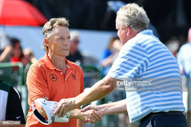 Bernhard Langer of Germany shakes hands with Colin Montgomerie of Scotland on the 18th green during the first round of the PGA TOUR Champions DICK'S...