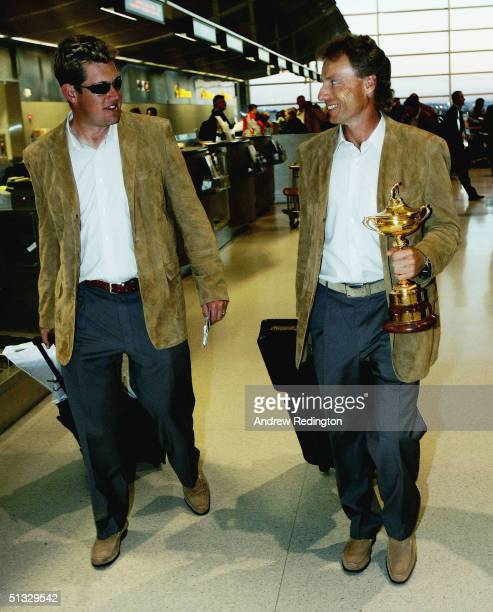 Bernhard Langer of Germany the team captain walks with the trophy along side Lee Westwood of England as the victorious European Ryder Cup team...