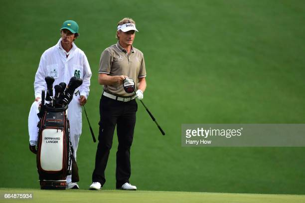 Bernhard Langer of Germany waits on the tenth hole with caddie Terry Holt during a practice round prior to the start of the 2017 Masters Tournament...