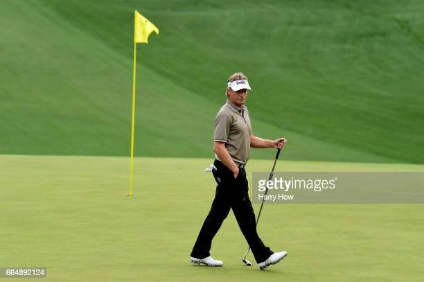 Bernhard Langer of Germany walks on the tenth green during a practice round prior to the start of the 2017 Masters Tournament at Augusta National...
