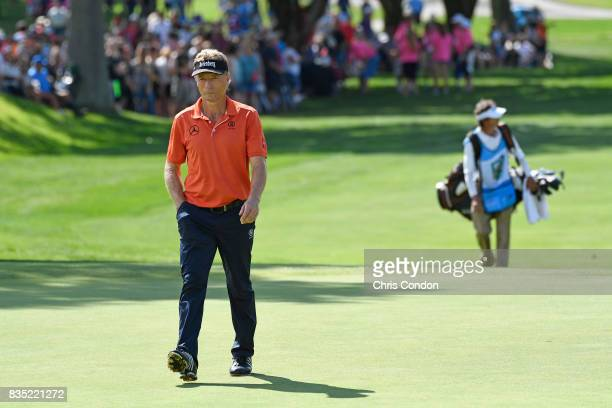 Bernhard Langer of Germany walks to the 18th green during the first round of the PGA TOUR Champions DICK'S Sporting Goods Open at EnJoie Golf Course...