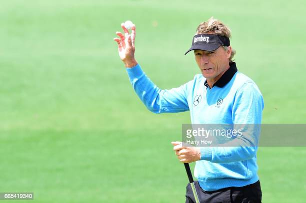 Bernhard Langer of Germany waves on the second hole after making a putt for birdie during the first round of the 2017 Masters Tournament at Augusta...