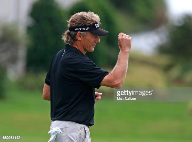 Bernhard Langer of Germany waves to the gallery after making a birdie putt on the first hole during the first round of the SAS Championship at...