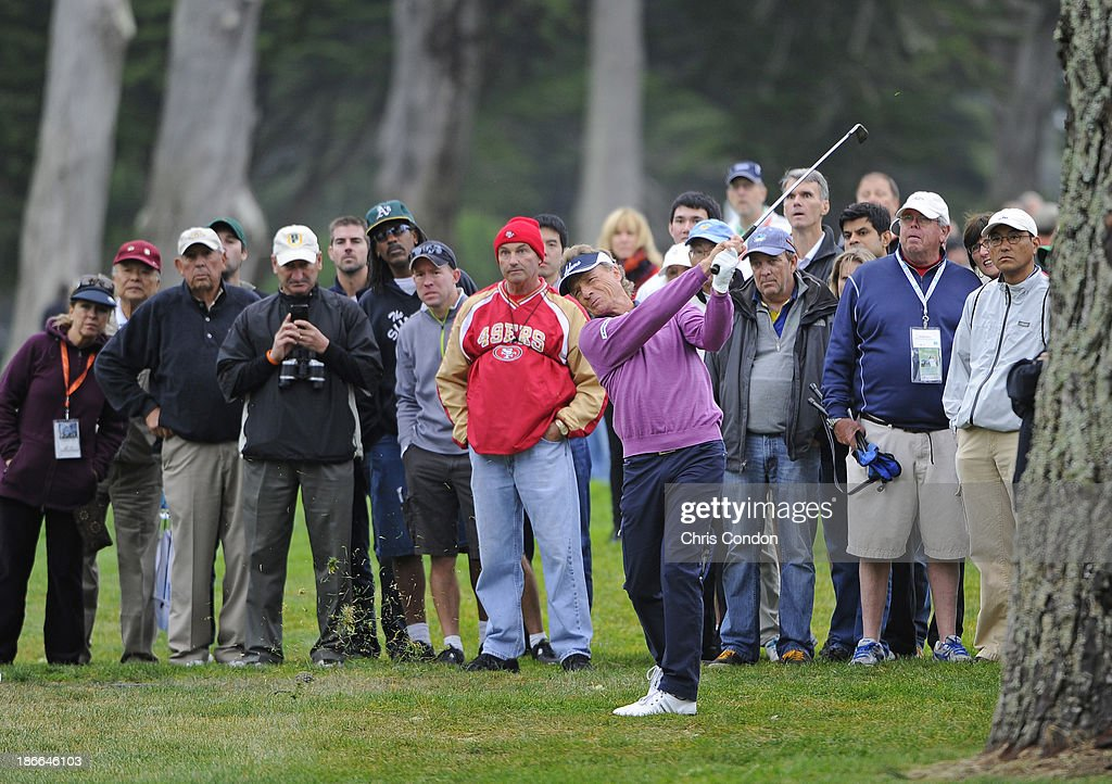 Bernhard Langer of Gernamy hits from the trees on the 5th hole during the third round of the Charles Schwab Cup Championship at TPC Harding Park on November 2, 2013 in San Francisco, California.