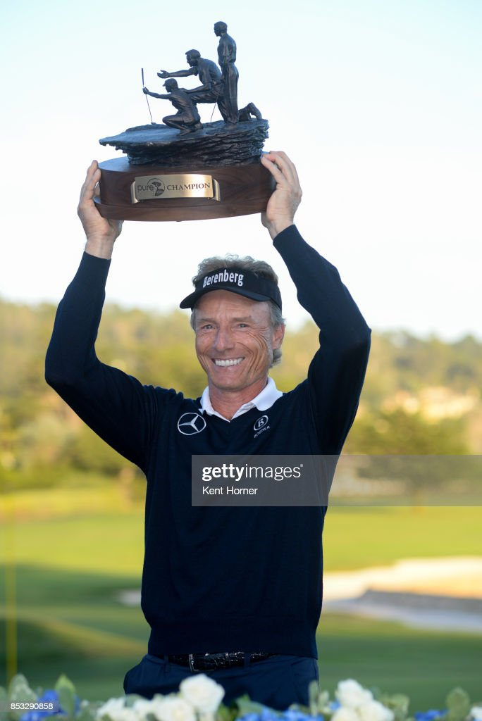 Bernhard Langer poses with the champion's trophy after winning in the final round of the Champions Tour Pure Insurance Championship on September 24, 2017 in Pebble Beach, California.
