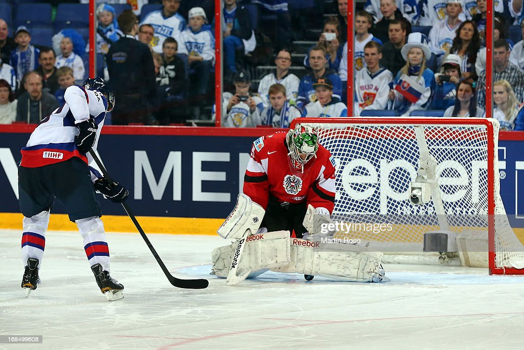 Bernhard Starkbaum (R), goaltender of Austria saves the penalty of <a gi-track='captionPersonalityLinkClicked' href=/galleries/search?phrase=Miroslav+Satan&family=editorial&specificpeople=201484 ng-click='$event.stopPropagation()'>Miroslav Satan</a> (L) of Slovakia during the shut out during the IIHF World Championship group H match between Slovakia and Austria at Hartwall Areena on May 10, 2013 in Helsinki, Finland.