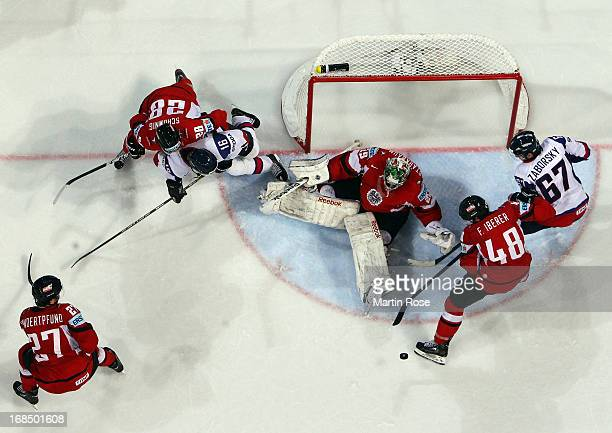 Bernhard Starkbaum goaltender of Austria saves the shot of Tomas Zaborsky of Slovakia during the IIHF World Championship group H match between...
