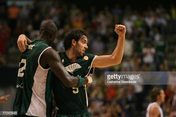 Berni Rodriguez and Boniface N'Dong of the Unicaja are celebrating the win over the Memphis Grizzlies after the game during the EA Sports NBA Europe...