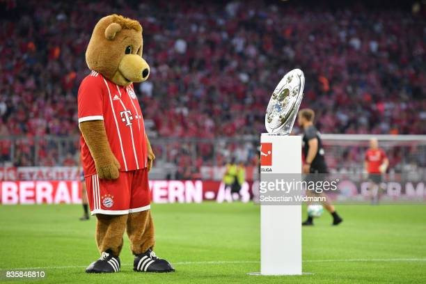 Berni the mascot of Bayern Muenchen looks at the Bundesliga trophy prior to the Bundesliga match between FC Bayern Muenchen and Bayer 04 Leverkusen...