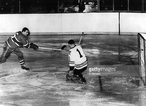 Bernie Boom Boom' Geoffrion of the Montreal Canadiens scores a goal on goalie Glen Hall of the Chicago Blackhawks during the Stanley Cup SemiFinals...
