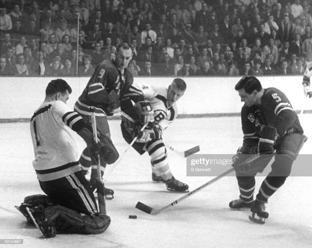 Bernie 'Boom Boom' Geoffrion #5 of the New York Rangers tries to score against Eddie Johnston #1 of the Boston Bruins as Reggie Fleming #9 of the Rangers and <a gi-track='captionPersonalityLinkClicked' href=/galleries/search?phrase=Bobby+Orr&family=editorial&specificpeople=204573 ng-click='$event.stopPropagation()'>Bobby Orr</a> #4 of the Bruins fight for position during their game circa 1966 at the Madison Square Garden in New York, New York.