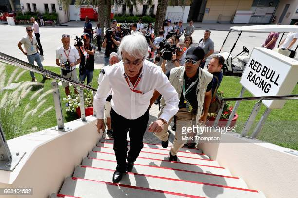 Bernie Ecclestone Chairman Emeritus of the Formula One Group walks into the Red Bull Racing hospitality area during practice for the Bahrain Formula...