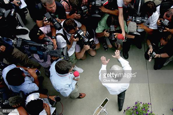 Bernie Ecclestone holds his hands up to the waiting press as he exits the team meeting to decide the fate of the United States F1 Grand Prix at the...