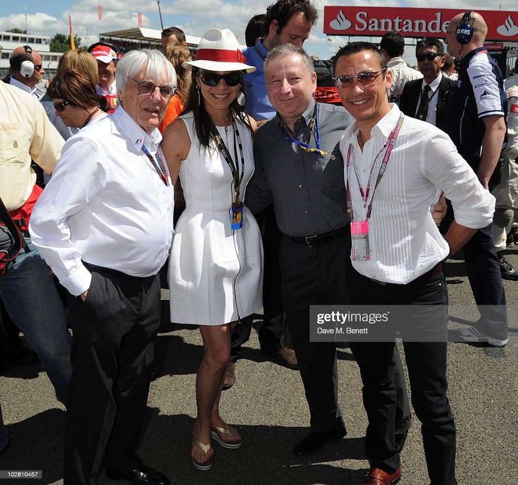 <a gi-track='captionPersonalityLinkClicked' href=/galleries/search?phrase=Bernie+Ecclestone&family=editorial&specificpeople=211579 ng-click='$event.stopPropagation()'>Bernie Ecclestone</a>, Michelle Yeo, <a gi-track='captionPersonalityLinkClicked' href=/galleries/search?phrase=Jean+Todt&family=editorial&specificpeople=206323 ng-click='$event.stopPropagation()'>Jean Todt</a> and <a gi-track='captionPersonalityLinkClicked' href=/galleries/search?phrase=Frankie+Dettori&family=editorial&specificpeople=167142 ng-click='$event.stopPropagation()'>Frankie Dettori</a> visit the F1 grid during race day ahead of the Formula One British Grand Prix at Silverstone on July 11, 2010 in Northampton, England.