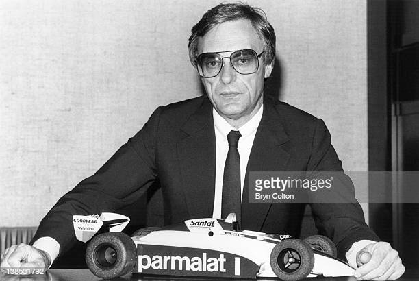 Bernie Ecclestone owner of the Brabham Grand Prix team poses for a photograph in his office with a model of a Brabham Grand Prix car at the teams...