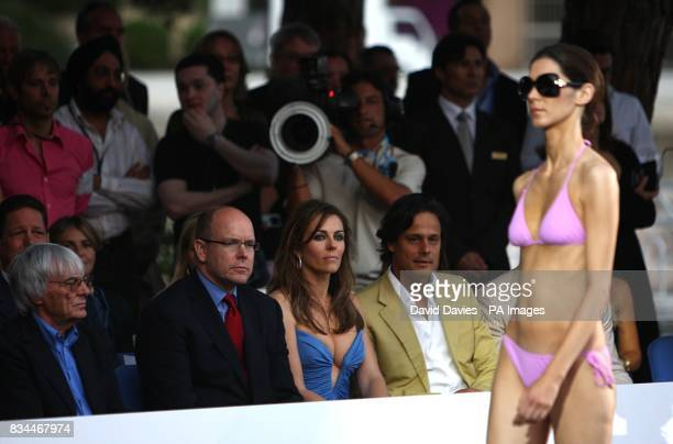Bernie Ecclestone Prince Albert of Monaco Liz Hurley and Arun Nayar watch the fashion show at the Grand Prix and Fashion Unite at The Amber Lounge Le...