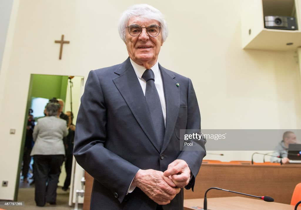 <a gi-track='captionPersonalityLinkClicked' href=/galleries/search?phrase=Bernie+Ecclestone&family=editorial&specificpeople=211579 ng-click='$event.stopPropagation()'>Bernie Ecclestone</a>, the 83-year-old controlling business magnate in Formula One racing, arrives for the second day of his trial for bribery on May 2, 2014 in Munich, Germany. Ecclestone is accused of bribing BayernLB bank employee Gerhard Gribkowsky to ensure the sale of SLEC Holdings, the parent company of Formula One, to private equity firm CVC.