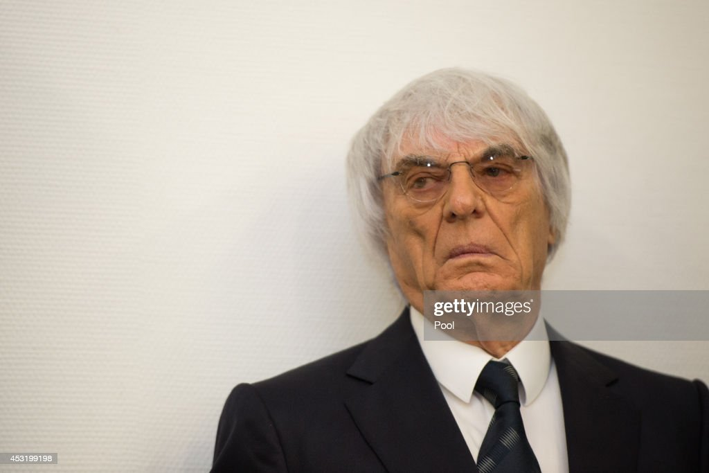 <a gi-track='captionPersonalityLinkClicked' href=/galleries/search?phrase=Bernie+Ecclestone&family=editorial&specificpeople=211579 ng-click='$event.stopPropagation()'>Bernie Ecclestone</a>, the head of Formula One racing, arrives in court to face charges of bribery on August 5, 2014 in Munich, Germany. Ecclestone is reportedly seeking a deal with prosecutors that would spare him from jail time in exchange for payments of a USD 100 million fine and EUR 25 million to to bank BayernLB. German prosecutors say they would accept an offer of $100m (£60m) from Formula 1 chief <a gi-track='captionPersonalityLinkClicked' href=/galleries/search?phrase=Bernie+Ecclestone&family=editorial&specificpeople=211579 ng-click='$event.stopPropagation()'>Bernie Ecclestone</a> to end his trial on bribery charges. The Munich state court is expected to agree to the offer later on Tuesday. Ecclestone was accused of bribing a BayernLB employee in connection with the sale of a portion of Formula One.