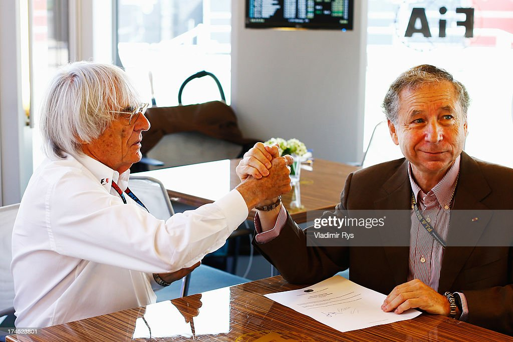 <a gi-track='captionPersonalityLinkClicked' href=/galleries/search?phrase=Bernie+Ecclestone&family=editorial&specificpeople=211579 ng-click='$event.stopPropagation()'>Bernie Ecclestone</a> the President and CEO of the Formula One Group and <a gi-track='captionPersonalityLinkClicked' href=/galleries/search?phrase=Jean+Todt&family=editorial&specificpeople=206323 ng-click='$event.stopPropagation()'>Jean Todt</a> the President of the FIA sign a memorandum agreement setting out the framework for implementation of the 2013 Concorde Agreement prior to the qualifying session for the Hungarian Formula One Grand Prix at Hungaroring on July 27, 2013 in Budapest, Hungary.